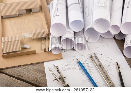 Workplace of architect - construction drawings, scale model of a house and tools stock photo
