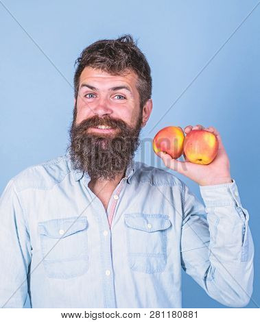Apples antioxidant compounds responsible health benefits. Nutritional choice. Man with beard hipster hold apple fruit in hand. Nutrition facts and health benefits. Apples popular type fruit in world stock photo