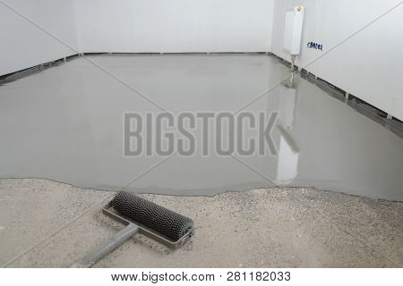 Self-leveling epoxy. Leveling with a mixture of cement floors stock photo