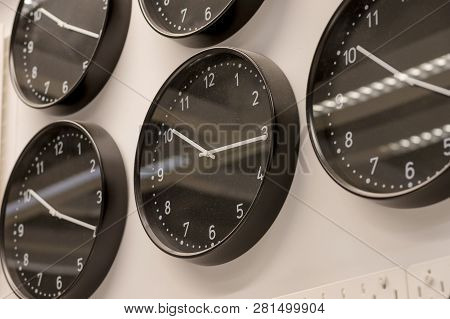 Many Different Wall Clock On The Wall .set Of Clockfaces Isolated. Concept Of Time Management.multip