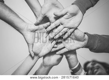 Close Up Of Young Teamwork Putting Their Hands Together For A New Collaboration - Cheerful Friends M