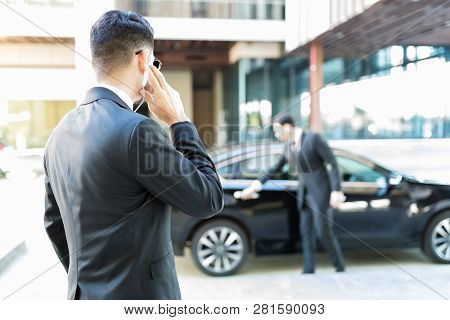 Protection agent in suit getting constant updates through earpiece to avoid danger stock photo