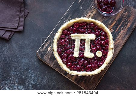 Pi Day Cherry Pie - making homemade traditional Cherry Pie with Pi sign for March 14th holiday, close up. stock photo