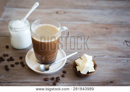 Bulletproof coffee, blended with organic butter and MCT coconut oil, paleo, keto, ketogenic drink breakfast. stock photo