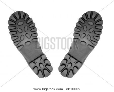 A pair of hiking boots from underneath with just the soles visible stock photo