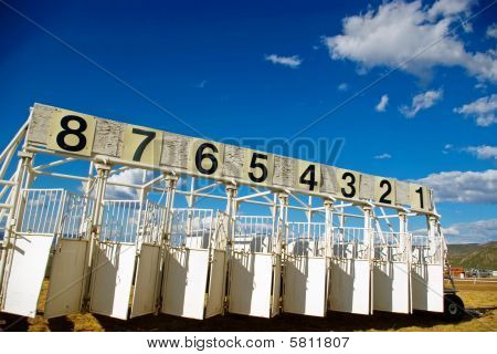 A portable horse race starting gate at the county fair. stock photo