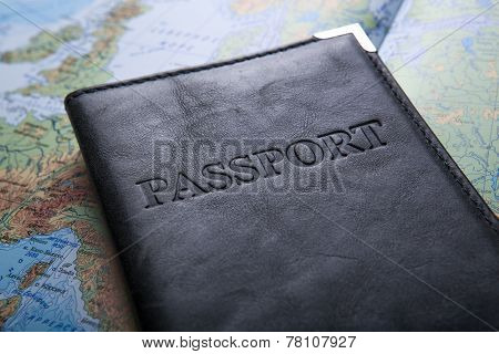 passport in the bag on a map close up stock photo