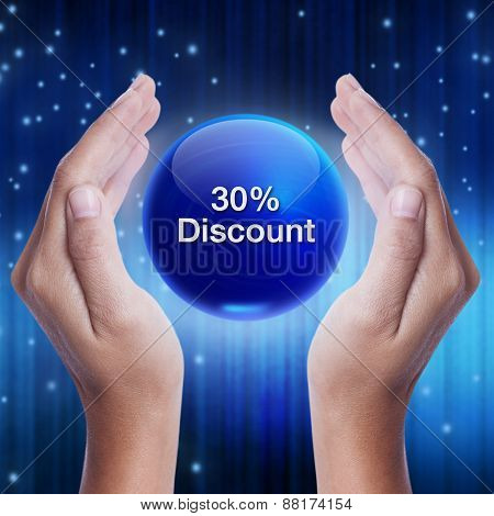 Hand showing blue crystal ball with 30 percent discount word. business concept stock photo