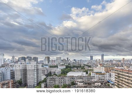 KUNMING CHINA - JUN 28: Cityscape and building in downtown Kunming China on June 28 2015. Kunming is capital of Yunnan province most famous city of southwest china. stock photo