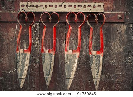 Antique scissors hang on the door. Antiques of Greece and Cyprus stock photo