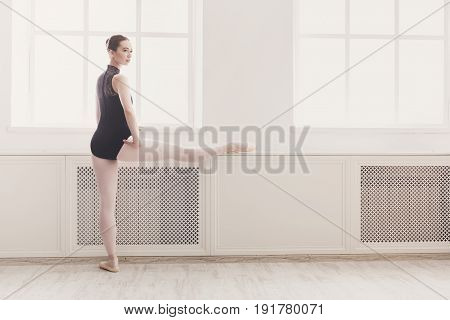 Ballerina. Classical Ballet dancer practice stretching near window