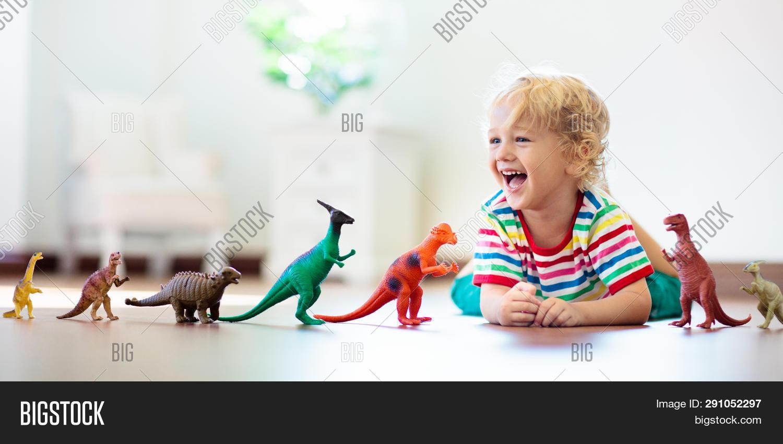 Diplodocus,Tyrannosaurus,animal,archaeologist,archeology,baby,biology,boy,child,childhood,children,cute,dino,dinosaur,dragon,education,evolution,explorer,extinct,fossils,fun,funny,geology,happy,home,imagination,jurassic,kid,kindergarten,learn,little,paleontologist,paleontology,park,plastic,play,playing,prehistoric,preschool,reptile,school,science,study,t-rex,toy,white,young