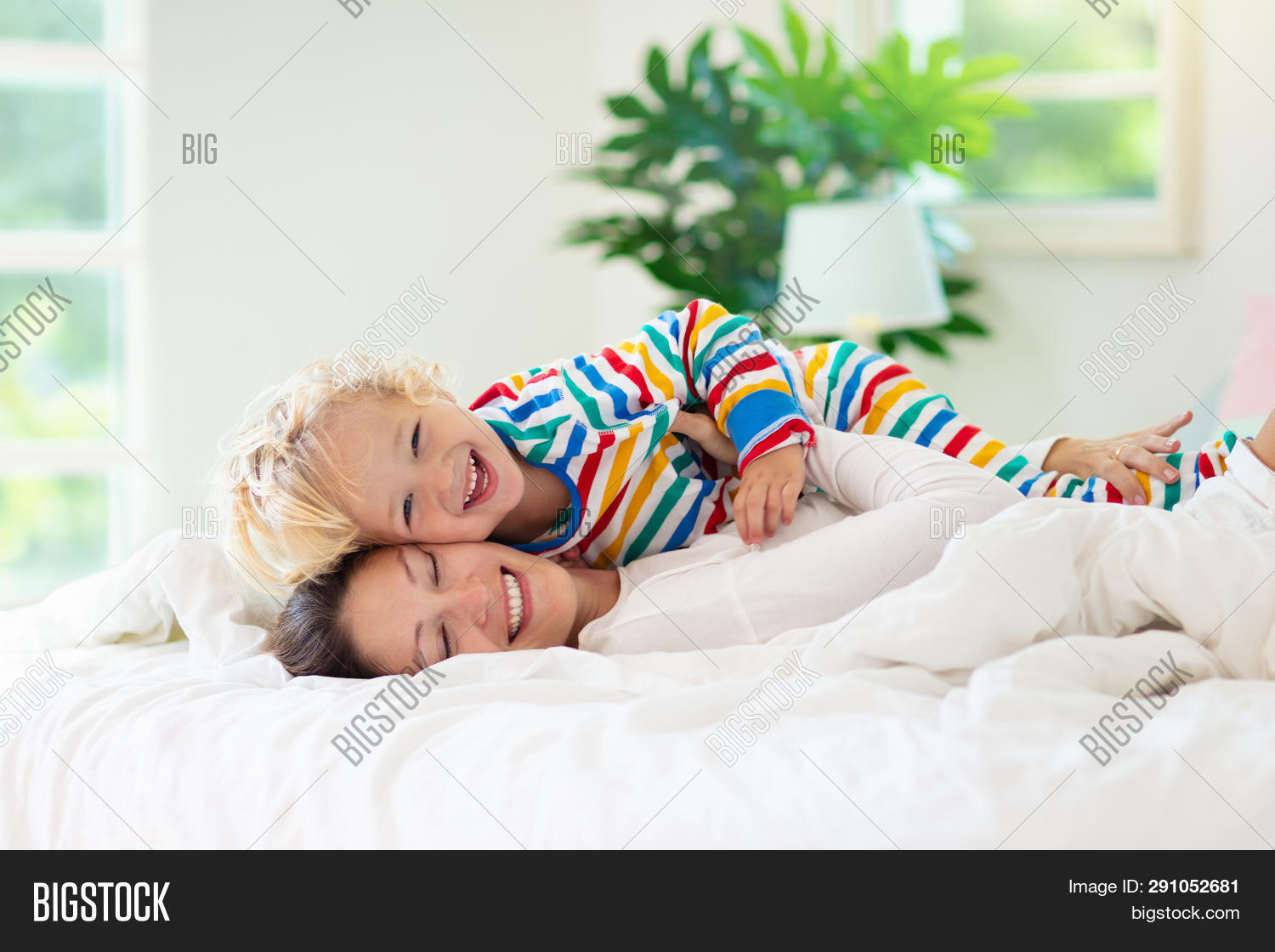 baby,bed,bedding,bedroom,blanket,blond,boy,care,caucasian,child,childhood,children,curly,daughter,day,family,fun,girl,happiness,happy,home,infant,kid,lifestyle,little,love,mom,morning,mother,nap,pajamas,parent,people,pillow,play,playing,room,sleep,sleeping,sleepwear,small,son,textile,tickle,wear,white,window,woman,yawn,young