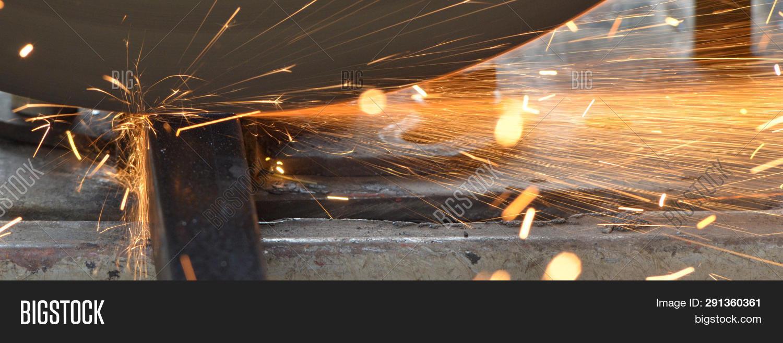 Spark Stream Of Cutter Machine Cutting Iron Pipe, Spark Light, Industrial Sparkle Stream, Iron Indus