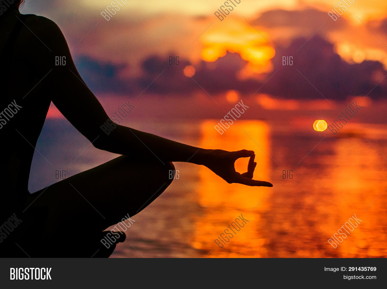 Woman Meditating, Relaxing In Yoga Pose At Sunset, Zen Meditation