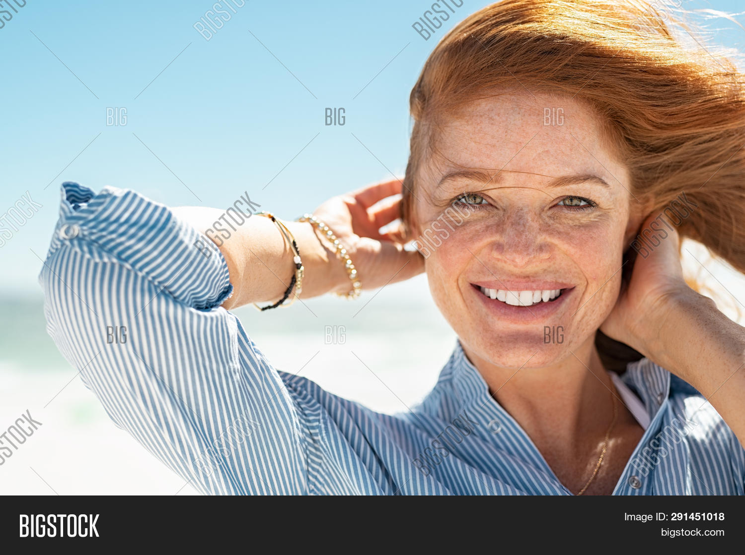 attractive,beach,beautiful,beautiful woman,beauty,breeze,candid,care,carefree,carefree woman,casual,caucasian,cheerful,closeup,complexion,daydreaming,enjoy,face,freckle face,freckles,fresh,fun,girl,hair,happy,healthy,looking,looking at camera,mature,mid adult woman,middle aged woman,natural,outdoor,people,portrait,red,red hair,relax,sea,seaside,skin,skin care,skincare,smiling,summer,sun,sunbathing,toothy smile,wind,young