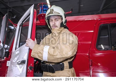 Emergency Safety. Protection, Rescue From Danger. Fire Fighter In Protective Helmet. Fire Truck Read