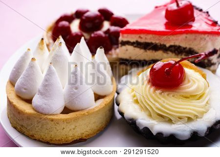 dessert background. delicious assorted cakes. cream cheese cupcake, berry tart, lemon meringue tart. sweet treats and cookies, confectionery stock photo