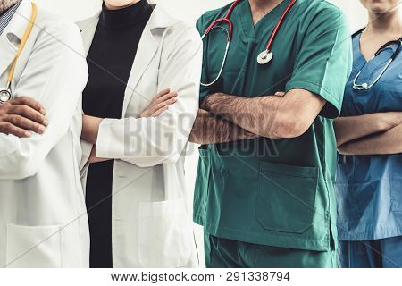 Doctors at hospital working with other doctor. Healthcare medical and doctor staff services. stock photo