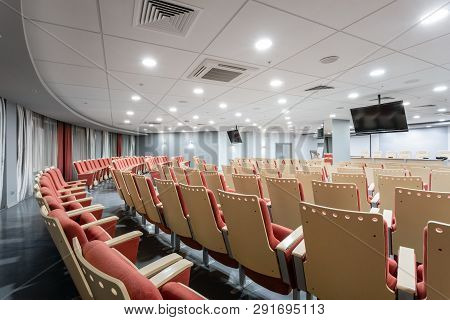 Big Empty Modern Conference Hall In Luxury Hotel. Audience For Speakers At Business Convention And P