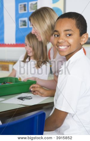 Students in art class with teacher (selective focus) stock photo