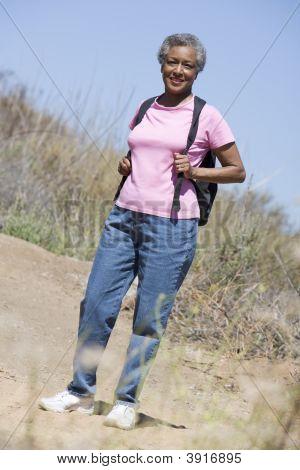 Senior woman on a walking trail stock photo
