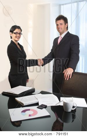 Young business people are shaking hands after a business deal. stock photo