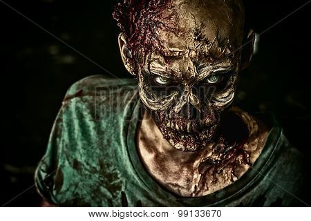 Close-up picture of a shocking terrifying zombie man. Frightfulness. Halloween.