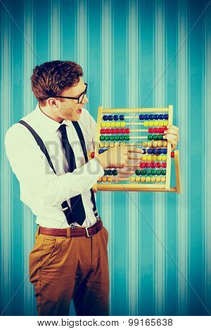 Geeky businessman using an abacus against blue background stock photo