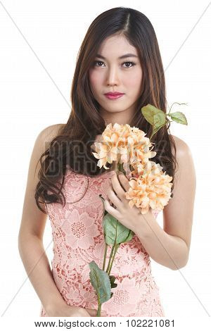 pretty asian woman shooting with flower on white background stock photo