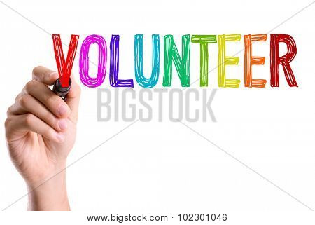 Hand with marker writing: Volunteer stock photo