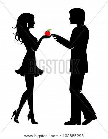 Beautiful elegant woman gives  man apple forbidden fruit stock photo