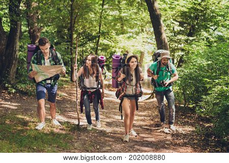 Trekking, Camping And Wild Life Concept. Four Best Friends Are Hiking In The Spring Woods, The Guy I