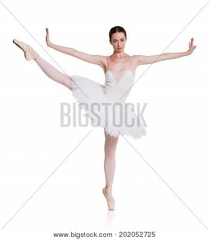 Graceful serious ballerina expressing rejection in her dance. Classical ballet dancer in tutu skirt moving emotionaly at white isolated background