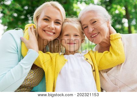 family, generation and people concept - happy smiling woman with daughter and senior mother sitting
