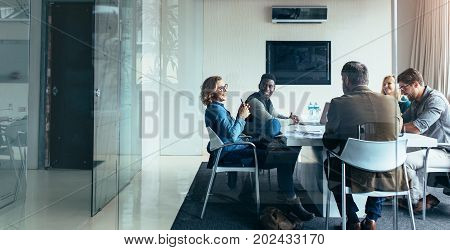 Business people working and discussing together in meeting at office. Team of successful people in business meeting.