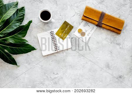 How much. Restaurant bill, bank card, wallet, coins near cup of coffee on light stone table top view.