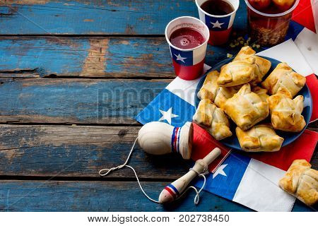 Chilean independence day concept. fiestas patrias. Chilean typical dish and drink on independence day party 18 september. Mini empanadas mote con huesillo wine with toasted flour chicha and tipical play emboque. stock photo