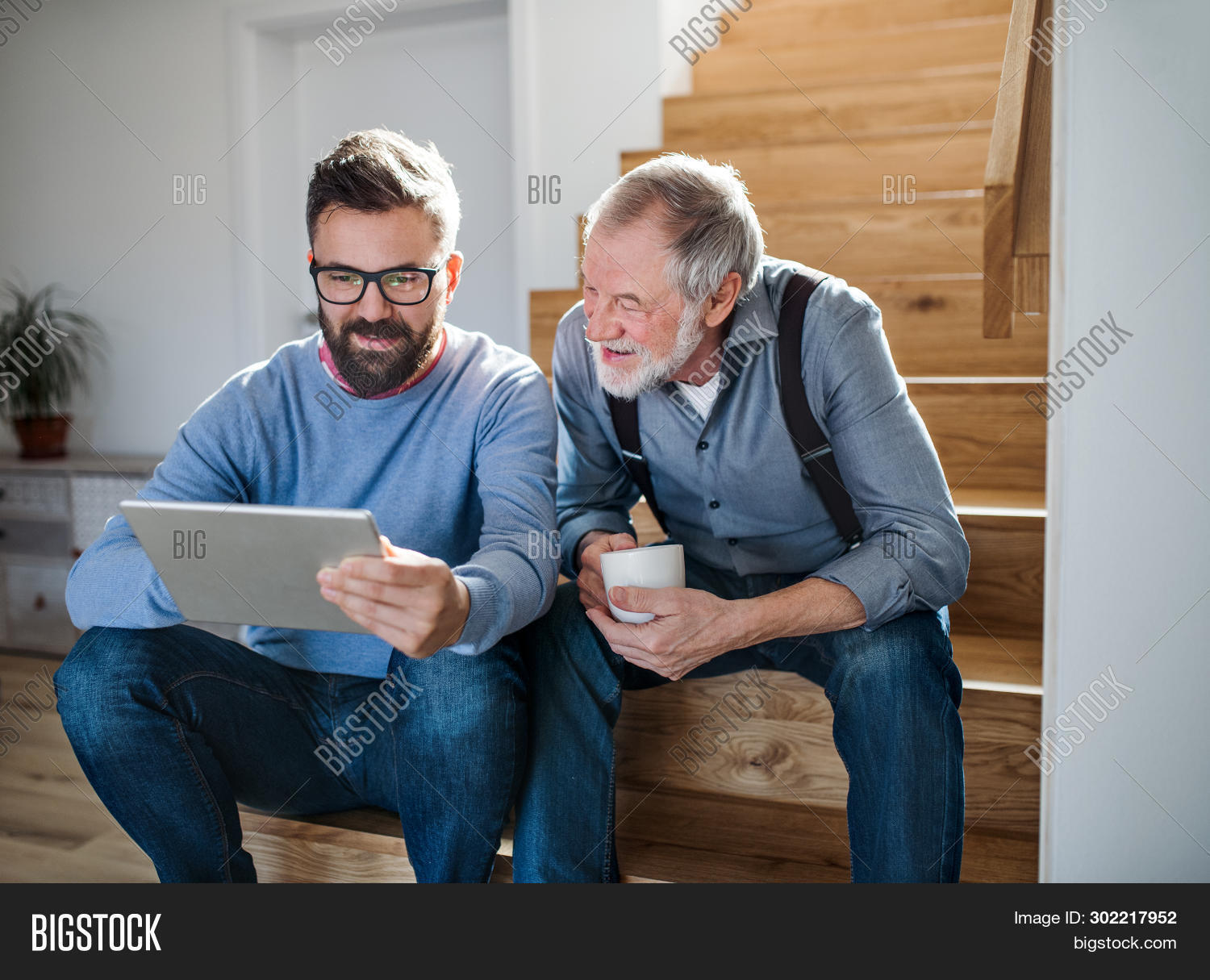 adult,apartment,beard,bottom,caucasian,coffee,computer,converasation,cup,dad,daddy,day,discussion,family,fathers,flat,generations,happy,hipster,home,house,indoors,inside,jeans,leisure,love,male,mature,men,mustache,old,parent,pc,people,quality,relationship,relaxing,senior,sitting,son,spending,stairs,tablet,talk,talking,time,together,two,wooden