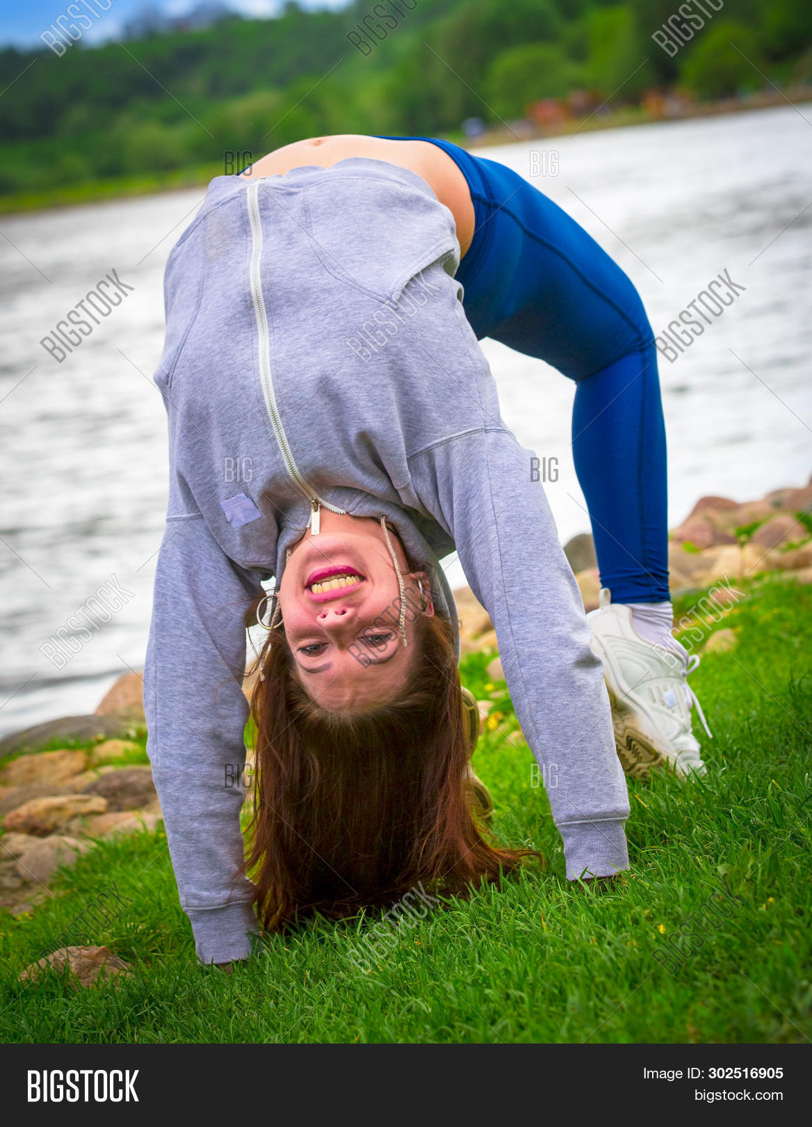 Young Girl Goes In For Sports In Nature. Healthy Lifestyle.flaxible Child Doing Joga Poses Bridge St