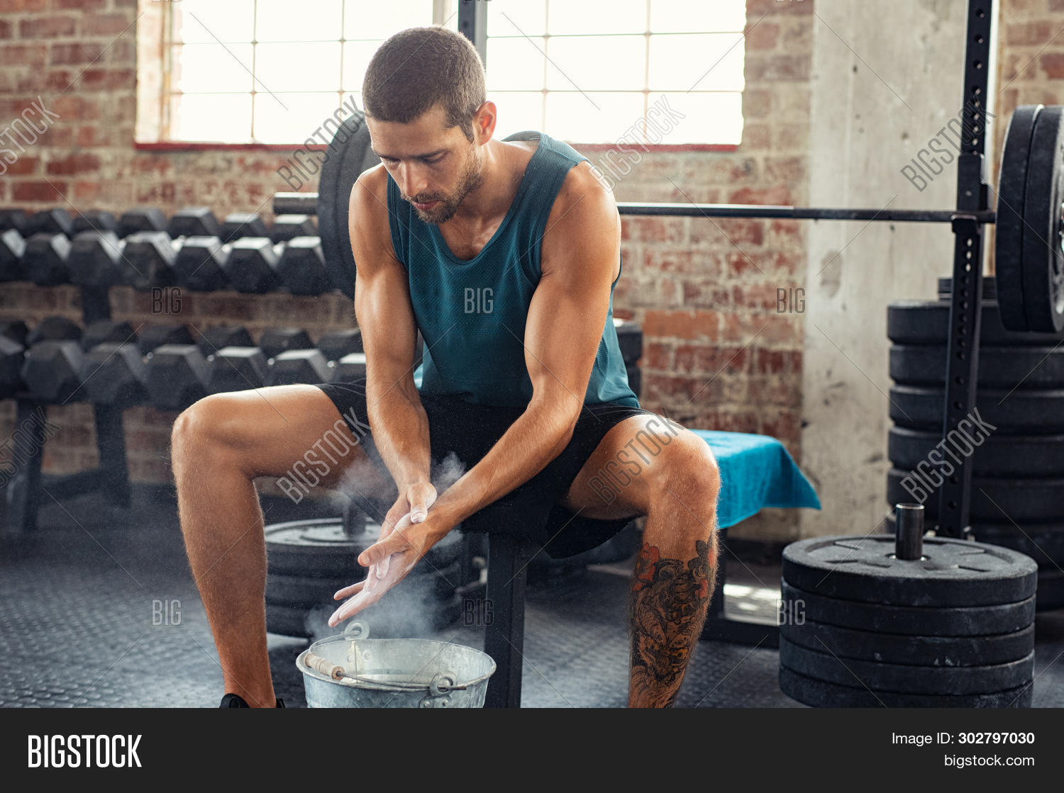 active,athlete,athletic,bench,bodybuilder,bucket,chalk,challenge,clapping,concentrated,concentration,cross,crossfit training,dedication,determination,determined man,effort,exercise,fit,fitness,fitness man,fitness training,gym,gym workout,gymnasium,hand,healthy,lifting,magnesium,magnesium powder,man,muscle,muscular,people,powder,preparing,press,rubbing hands,sport,sportswear,strength,strong,talcum,training,weight,weight lifting,workout,young,young man