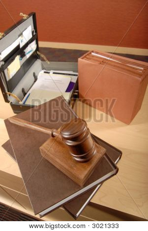 Busy lawyer's desk with scattered books and papers stock photo