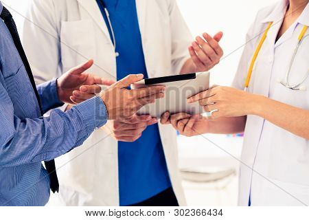 Healthcare people group and scientist meeting. Professional doctor working in hospital office with other doctors, nurse and businessman. Medical technology research institute health insurance concept. stock photo