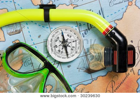 swimming accessories and items for leisure travel on a background map stock photo