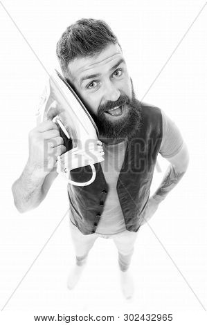 Man speaking iron as phone isolated white background. Wrong communication way. Bearded hipster use iron instead phone. Call household service. Mobile communication concept. Need more communication. stock photo