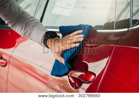 Man asian inspection and cleaning Equipment car wash With red car For cleaning to quality to customer on car showroom of service transport automobile transportation automotive image. stock photo