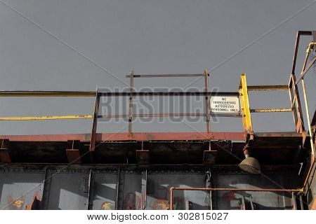 Catwalks against a gray sky, American industrial site, horizontal aspect stock photo