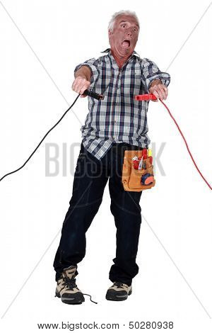 Man getting an electric shock stock photo