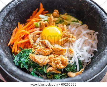 Bibimbap korean food in black stone bowl ** Note: Shallow depth of field stock photo