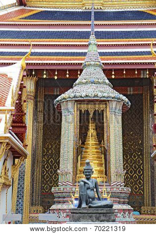 Bronze statue of a seated hermit behind the ubosoth of the Emerald Buddha at Wat Phra Kaew in the Grand Palace complex in Bangkok Thailand stock photo